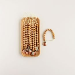 Schnullerkette Holz mit Silikonperle Gold